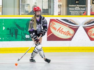 image of youth girl ball hockey player
